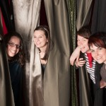 what could happen in this cute booth with curtains?